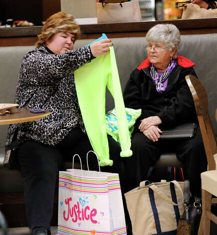 Karen Sharp, of Newburgh, N.Y., shopping with her mother, Claudia Kaiser, gets an early start on Christmas shopping at the Danbury Fair Mall, Monday, November 19, 2012. Photo: Carol Kaliff / The News-Times