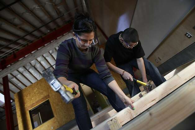 Advanced carpentry students Lucerito Martinez and Sergio Navarro frame a stage at John O'Connell High School last year. Photo: Lea Suzuki, The Chronicle
