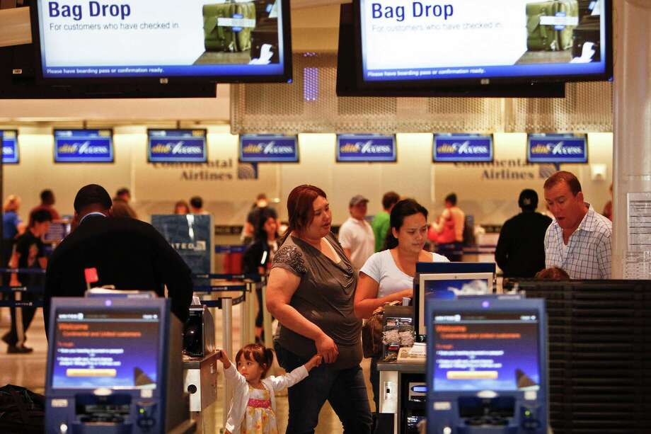 Day-before-Thanksgiving travelers check in last year in Terminal C of Bush Intercontinental Airport. This year, Bush Intercontental is offering valet service, which will also be added at Hobby starting Dec. 3. Photo: Michael Paulsen, Staff / © 2011 Houston Chronicle