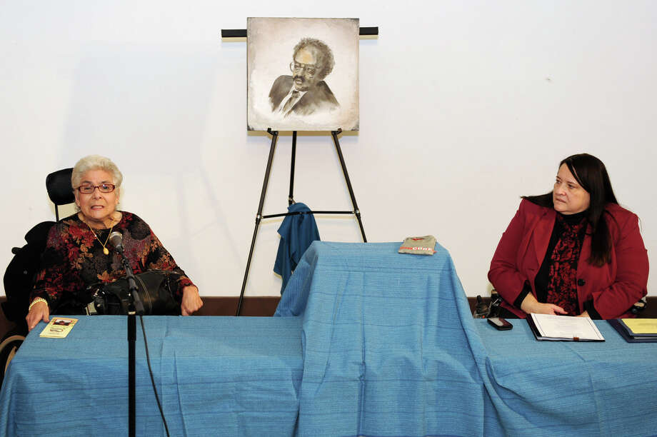 Bobbi Linn, disability advocate and long time friend, speaks as The Independent Living Center of the Hudson Valley dedicates four programs - advocacy, arts, education, and communication - to the late Patricio ?Pat? Figueroa on Friday, Nov. 16, 2012 in Troy, N.Y. Denise Figueroa sits on the right. Pat Figueroa was one of the nation?s most inspiring innovative leaders of the modern disability rights and independent living movements, and a long-time resident of the Capital Region. (Lori Van Buren / Times Union) Photo: Lori Van Buren