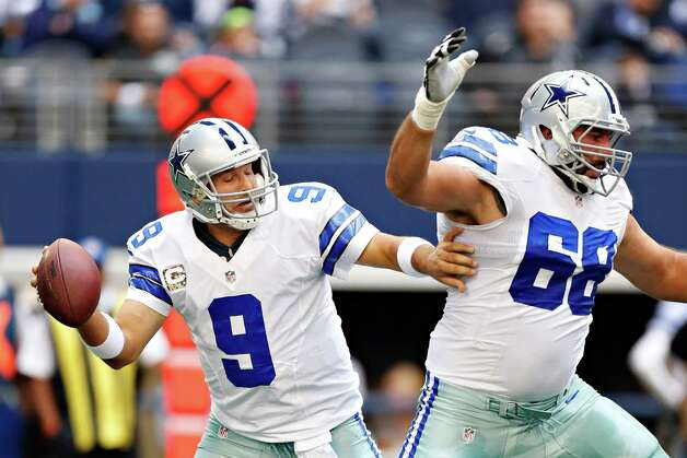 ARLINGTON, TX - NOVEMBER 18:  Tony Romo #9 tries to avoid his teammate Doug Free #68 of the Dallas Cowboys as he drops back to pass during a game against the Cleveland Browns at Cowboys Stadium on November 18, 2012 in Arlington, Texas. Photo: Wesley Hitt, Getty Images / 2012 Getty Images