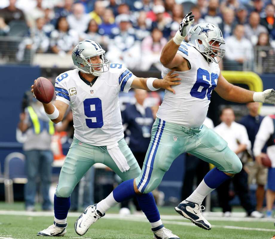 Dallas Cowboys quarterback Tony Romo (9) looks around tackle Doug Free (68) in the first half of an NFL football game against the Cleveland Browns Sunday, Nov. 18, 2012 in Arlington, Texas. (AP Photo/Sharon Ellman) Photo: Sharon Ellman, Associated Press / FR170032 AP