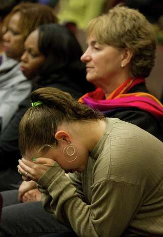 Keisha Brown, mother of fire victim Elias Castillo, places her head in her hands as she listens to closing arguments during the punishment phase of Jessica Tata's trial Monday, Nov. 19, 2012, in Houston. Tata was convicted of felony murder in the deaths of four toddlers during a fire at her day care in 2011. Photo: Brett Coomer, Houston Chronicle / © 2012 Houston Chronicle
