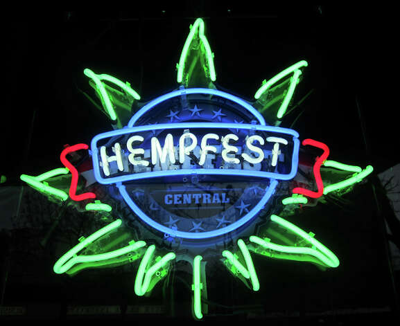 This neon sign hangs in the window of Hempfest Central, the office and retail store for the pro-pot movement that draws more than 300,000 people to Seattle for a three-day festival in Myrtle Edwards Park. Photo: Casey McNerthney/seattlepi.com