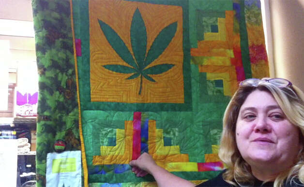 Hempfest Central general manager Sharon Whitson shows a quilt that is to be raffled on April 20. Photo: Casey McNerthney/seattlepi.com