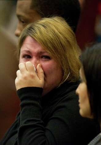 Tiffany Dickerson, mother of fire victims Shomari and Makayla Dickerson, reacts to a video during the closing arguments in the punishment phase of Jessica Tata's trial Monday, Nov. 19, 2012, in Houston. Tata was convicted of felony murder in the deaths of four toddlers during a fire at her day care in 2011. Photo: Brett Coomer, Houston Chronicle / © 2012 Houston Chronicle