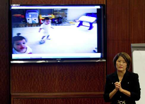 Prosecutor Connie Spence stands in front of a video screen as she makes her closing arguments during the punishment phase of Jessica Tata's trial Monday, Nov. 19, 2012, in Houston. Tata was convicted of felony murder in the deaths of four toddlers during a fire at her day care in 2011. Photo: Brett Coomer, Houston Chronicle / © 2012 Houston Chronicle