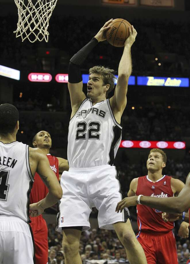 Spurs' Tiago Splitter (22) grabs a rebound against the Los Angeles Clippers in the first half of their game at the AT&T Center on Monday, Nov. 19, 2012. (Kin Man Hui / San Antonio Express-News)