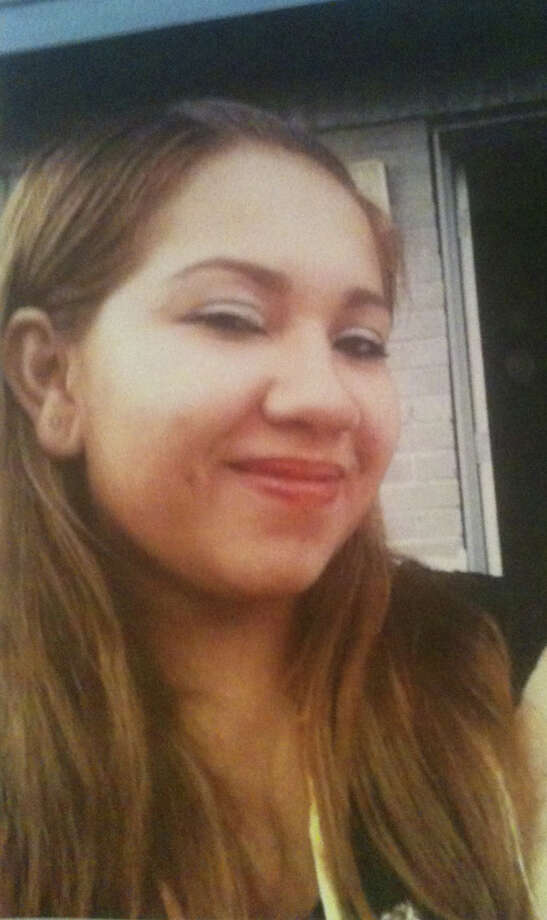 Vanessa Rodriguez, 23, was fatally shot inside her northwest Houston apartment on Thursday within arm's reach of her 1-year-old daughter, who was not injured. The suspect remains at large. Photo: HPD