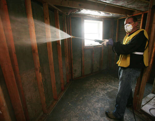 Mormon volunteer Todd Thompson, of New Canaan, power washes the walls of a basement during the church's Hurricane Sandy relief effort in the Far Rockaway section of Queens, NY, on Sunday, November 18, 2012. Photo: Brian A. Pounds / Connecticut Post