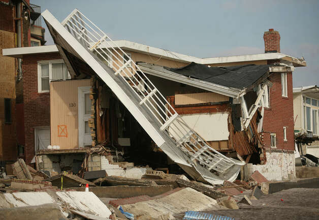A beachfront home destroyed during Hurricane Sandy in the Far Rockaway section of Queens, NY, on Sunday, November 18, 2012. Photo: Brian A. Pounds / Connecticut Post