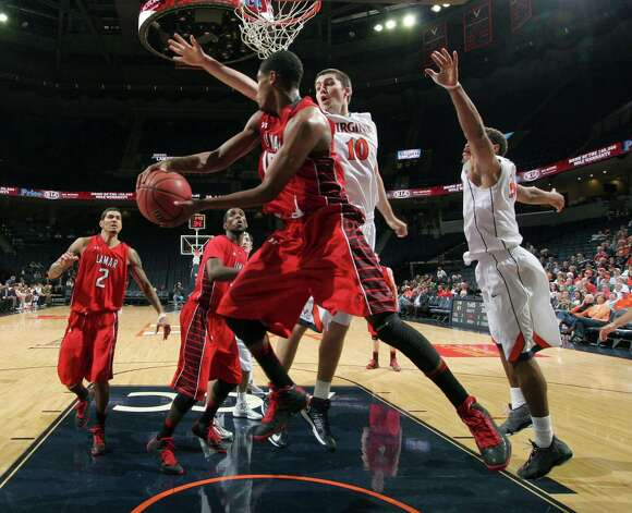 Lamar forward Rhon Mitchell (10) works against Virginia's Mike Tobey (10) during an NCAA college basketball game Monday, Nov. 19, 2012, in Charlottesville, Va. Virginia won 63-44. (AP Photo/The Daily Progress, Andrew Shurtleff) Photo: Andrew Shurtleff, MBR