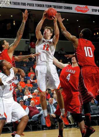 Virginia guard Joe Harris (12) shoots between Lamar defenders during an NCAA college basketball game Monday, Nov. 19, 2012, in Charlottesville, Va. Virginia won 63-44. (AP Photo/The Daily Progress, Andrew Shurtleff) Photo: Andrew Shurtleff, MBR