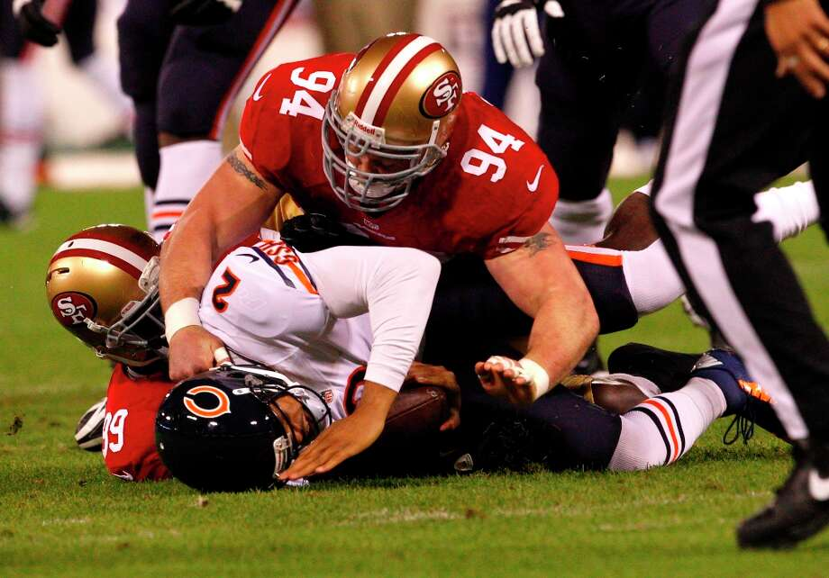 Defensive tackle Justin Smith (94) and Linebacker Aldon Smith (99) take down Chicago Bears quarterback Jason Campbell (2) during the first quarter of the San Francisco 49ers game against the Chicago Bears at Candlestick Park in San Francisco, Calif., on Sunday November 19, 2012. Photo: Carlos Avila Gonzalez, The Chronicle / ONLINE_YES