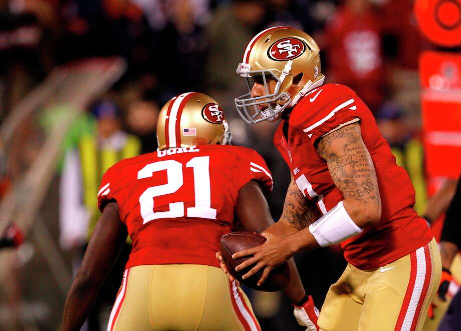 Quarterback Colin Kaepernick (7) on his first snap in the NFL as a starting quarterback during the San Francisco 49ers game against the Chicago Bears at Candlestick Park in San Francisco, Calif., on Monday November 19, 2012. Photo: Carlos Avila Gonzalez, The Chronicle / ONLINE_YES