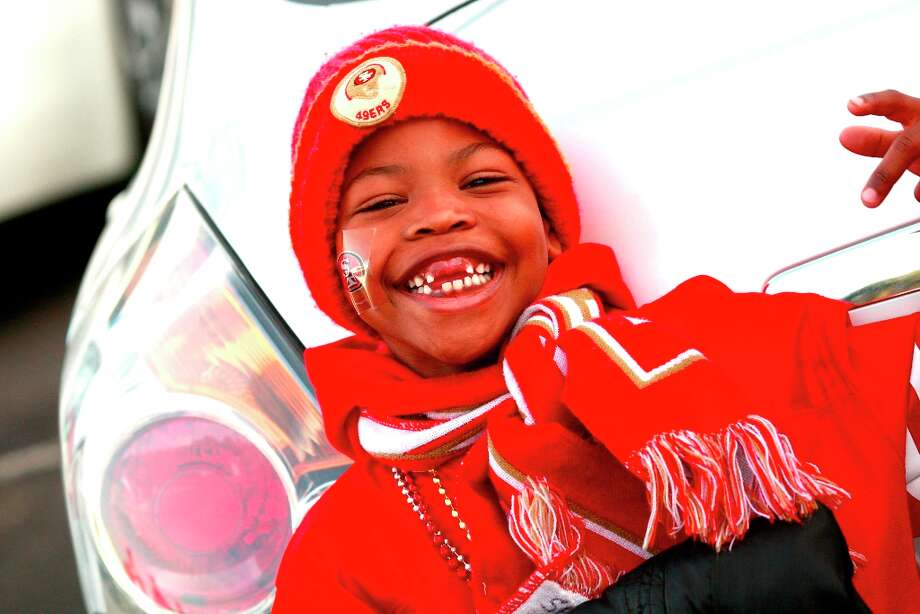 Saliou Sow from Oakland celebrates his 6th birthday with his family before the San Francisco 49ers game against the Chicago Bears at Candlestick Park in San Francisco, Calif., on Sunday November 19, 2012. Photo: Brant Ward, The Chronicle / ONLINE_YES