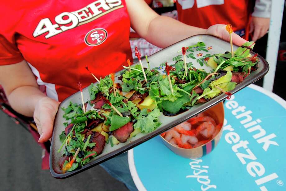 49ers fans go above and beyond for their tailgating parties serving both duck and shrimp before the San Francisco 49ers game against the Chicago Bears at Candlestick Park in San Francisco, Calif., on Sunday November 19, 2012. Photo: Brant Ward, The Chronicle / ONLINE_YES