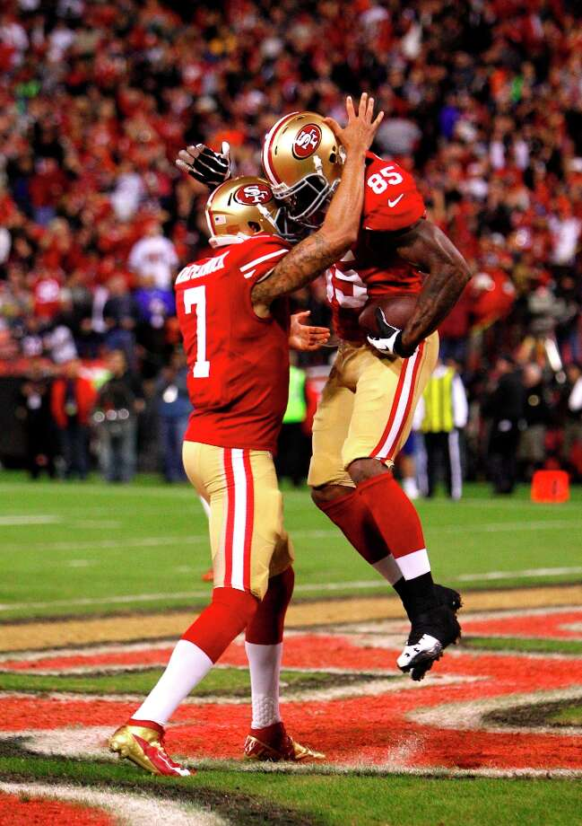 Quarterback Colin Kaepernick (7) celebrates with tight end Vernon Davis (85) after a touchdown in the first quarter of the San Francisco 49ers game against the Chicago Bears at Candlestick Park in San Francisco, Calif., on Monday November 19, 2012. Photo: Carlos Avila Gonzalez, The Chronicle / ONLINE_YES