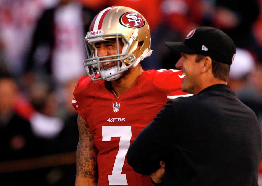 Quarterback Colin Kaepernick (7) talks with coach Jim Harbaugh before the San Francisco 49ers game against the Chicago Bears at Candlestick Park in San Francisco, Calif., on Sunday November 19, 2012. Photo: Carlos Avila Gonzalez, The Chronicle / ONLINE_YES