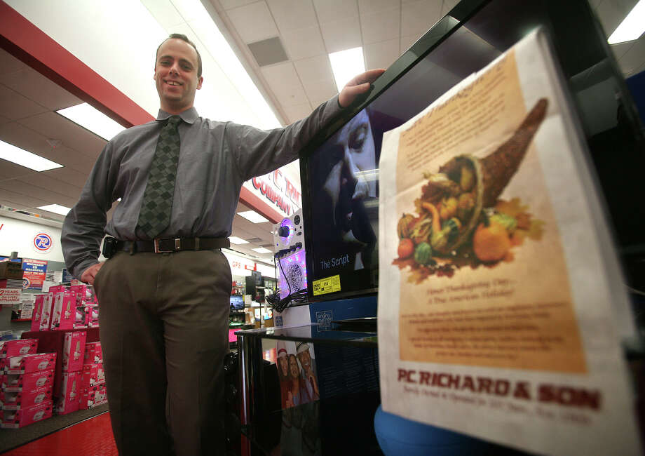 General Manager Robert Krynski displays the advertisement that P.C. Richard & Son has been running against Thanksgiving Day opening at the company's store in Milford on Monday, November 19, 2012. Photo: Brian A. Pounds / Connecticut Post