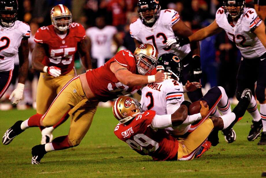 Defensive tackle Justin Smith (94) and Linebacker Aldon Smith (99) take down Chicago Bears quarterback Jason Campbell (2) during the first quarter of the San Francisco 49ers game against the Chicago Bears at Candlestick Park in San Francisco, Calif., on Monday November 19, 2012. Photo: Carlos Avila Gonzalez, The Chronicle / ONLINE_YES