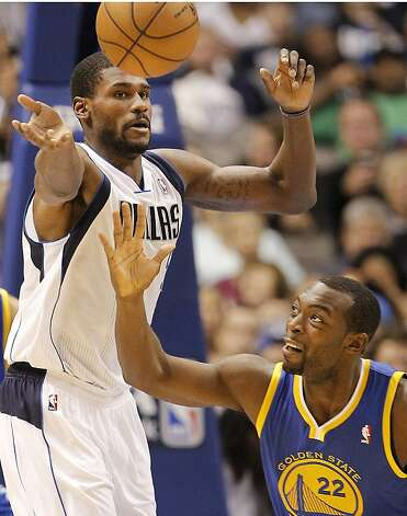 The Mavs' Bernard James (left) has the upper hand on Charles Jenkins in their quest for the ball. Photo: Brandon Wade, McClatchy-Tribune News Service