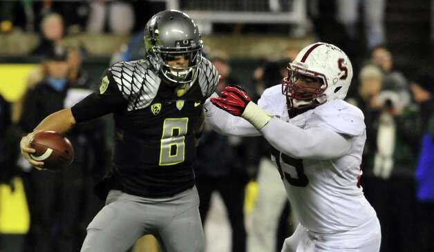 Oregon quarterback Marcus Mariota. Oregon (10-1, 7-1 Pac-12) is coming off a loss to Stanford. Oregon plays rival Oregon State on Saturday. Photo: Steve Dykes, Wires / 2012 Getty Images