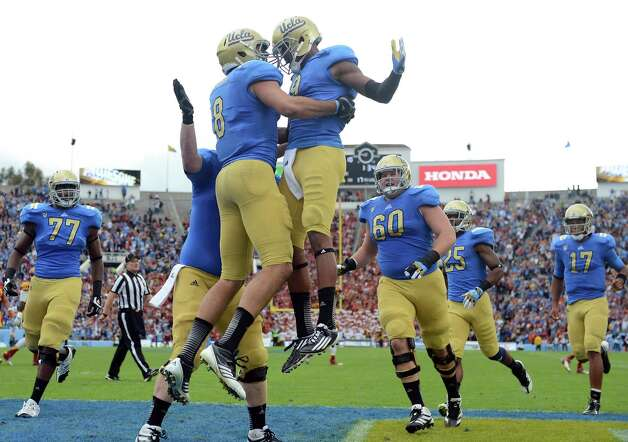 UCLA's Joseph Fauria (8) and Jerry Johnson. UCLA (9-2, 6-2 Pac-12) is coming off a victory over rival USC. UCLA plays at home Saturday against Stanford. Photo: Harry How, Getty Images / 2012 Getty Images