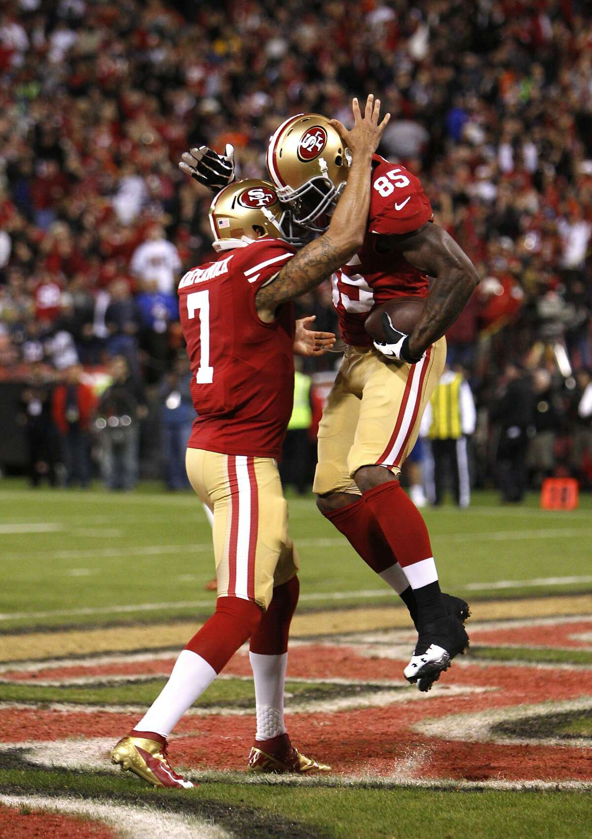 Quarterback Colin Kaepernick (7) celebrates with tight end Vernon Davis (85) after a touchdown in the first quarter of the San Francisco 49ers game against the Chicago Bears at Candlestick Park in San Francisco, Calif., on Sunday November 19, 2012.