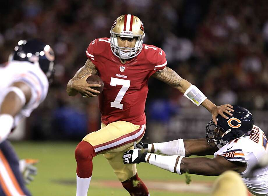With quarterback Alex Smith sidelined because of a concussion, Colin Kaepernick, No. 7, makes his first NFL start a memorable one. Kaepernick throws for 243 yards and two touchdowns, leading the 49ers to a rout of Chicago. Story in Sports, B1 Photo: Brant Ward, The Chronicle