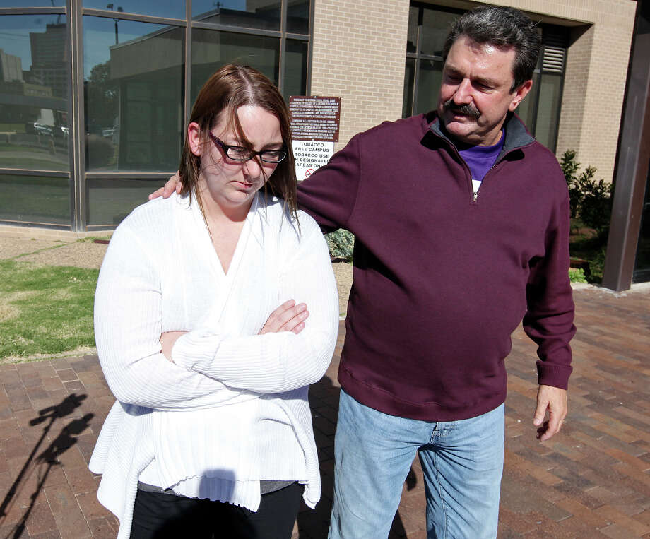 Heather Sanchez walks with attorney Bob Pottroff after speaking at a press conference in Midland on Monday.  Her husband, U.S. Army Sgt. Richard Sanchez is one of three people who remain hospitalized after Thursday's crash Photo: Edward A. Ornelas, Staff / © 2012 San Antonio Express-News