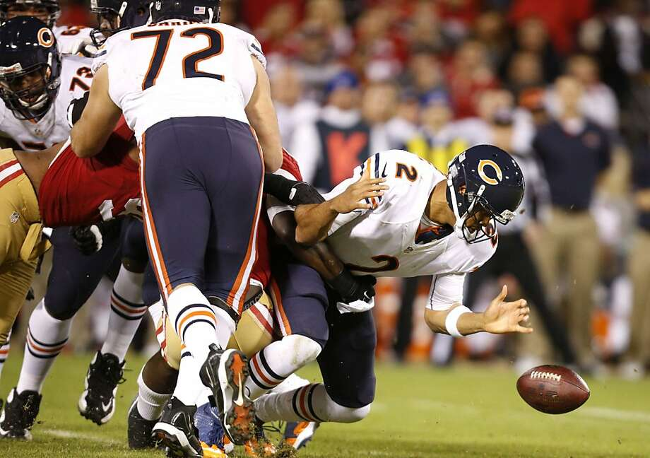 Chicago quarterback Jason Campbell (2) briefly looses the ball after being tackled by Linebacker Aldon Smith (99) during the San Francisco 49ers game against the Chicago Bears at Candlestick Park in San Francisco, Calif., on Monday November 19, 2012. Photo: Stephen Lam, Special To The Chronicle