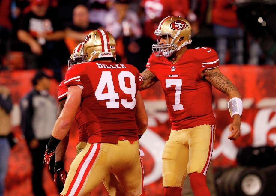 Quarterback Colin Kaepernick (7) celebrates with teammates Fullback Bruce Miller (49) after a big play in the first half of the San Francisco 49ers game against the Chicago Bears at Candlestick Park in San Francisco, Calif., on Sunday November 19, 2012. Photo: Carlos Avila Gonzalez, The Chronicle / ONLINE_YES