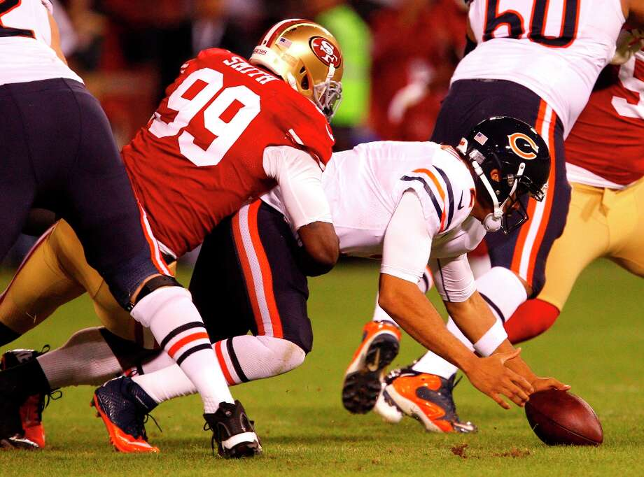 Chicago quarterback Jason Campbell (2) looses the ball as he's tackled by Linebacker Aldon Smith (99)  in the first half. He recovers the ball for a loss during the San Francisco 49ers game against the Chicago Bears at Candlestick Park in San Francisco, Calif., on Monday November 19, 2012. Photo: Carlos Avila Gonzalez, The Chronicle / ONLINE_YES