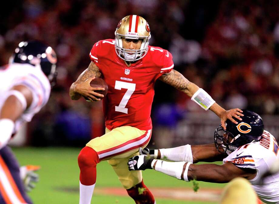 Quarterback Colin Kaepernick (7) for a gain in the second quarter of the San Francisco 49ers game against the Chicago Bears at Candlestick Park in San Francisco, Calif., on Sunday November 19, 2012. Photo: Brant Ward, The Chronicle / ONLINE_YES