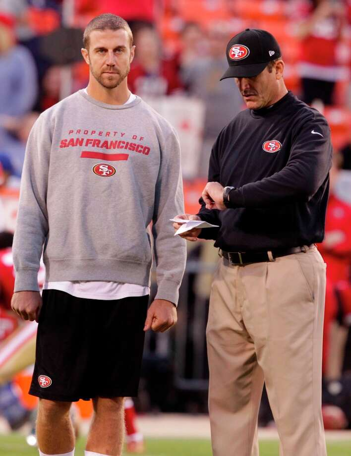 Quarterback Alex Smith (11) with coach Jim Harbaugh before the San Francisco 49ers game against the Chicago Bears at Candlestick Park in San Francisco, Calif., on Monday November 19, 2012. (Brant Ward / The Chronicle) Photo: Stephen Lam, Special To The Chronicle / ONLINE_YES