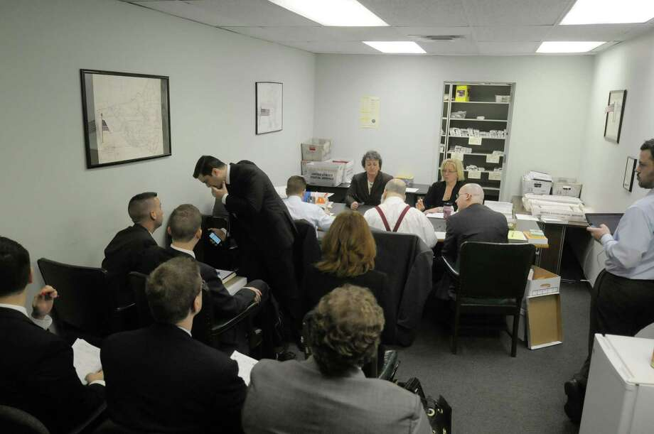 Representatives from Republican Assemblyman George Amedore's campaign and Cecilia Tkaczyk's campaign along with employees of the Albany County Board of Elections continue the counting of  absentee and affidavit ballots in the 46th State Senate race at the Albany County Board of Elections on Monday, Nov. 19, 2012 in Albany, NY.  (Paul Buckowski / Times Union) Photo: Paul Buckowski