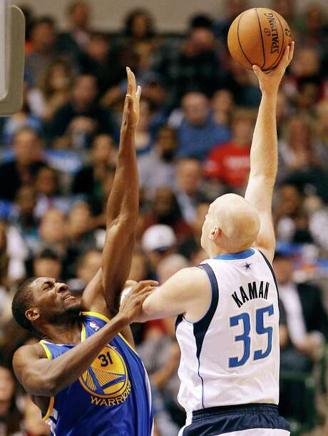 Chris Kaman, right, had 18 points and 17 rebounds, but the Mavericks fell to the Warriors in overtime. Photo: Brandon Wade, MBR / Fort Worth Star-Telegram
