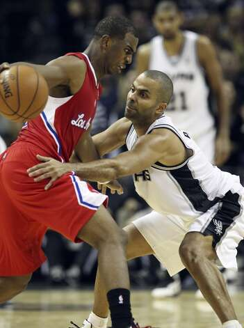 Spurs' Tony Parker (09) attempts a steal against Los Angeles Clippers' Chris Paul (03) in the second half of their game at the AT&T Center on Monday, Nov. 19, 2012. Clippers defeated the Spurs, 92-87. (Kin Man Hui / San Antonio Express-News)