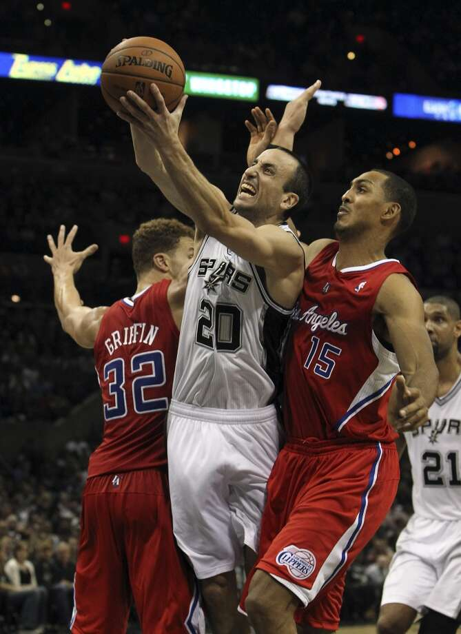 Spurs' Manu Ginobili (20) attempts to score between Los Angeles Clippers' Blake Griffin (32) and Ryan Hollins (15) in the second half of their game at the AT&T Center on Monday, Nov. 19, 2012. Clippers defeated the Spurs, 92-87. (Kin Man Hui / San Antonio Express-News)