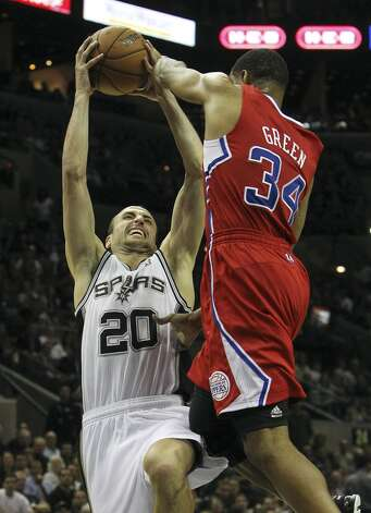 Spurs' Manu Ginobili (20) gets fouled by Los Angeles Clippers' Willie Green (34) in the second half of their game at the AT&T Center on Monday, Nov. 19, 2012. Clippers defeated the Spurs, 92-87. (Kin Man Hui / San Antonio Express-News)