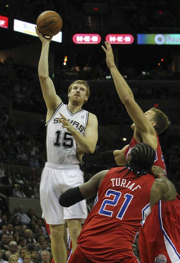 Spurs' Matt Bonner (15) scores against Los Angeles Clippers' Blake Griffin (32) in the second half of their game at the AT&T Center on Monday, Nov. 19, 2012. Clippers defeated the Spurs, 92-87. (Kin Man Hui / San Antonio Express-News)