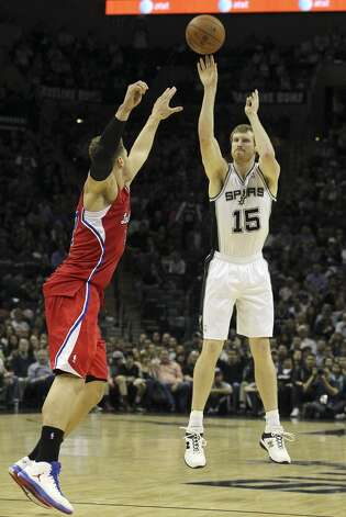 Spurs' Matt Bonner (15) hits a big three-pointer against Los Angeles Clippers' Blake Griffin (32) in the second half of their game at the AT&T Center on Monday, Nov. 19, 2012. Clippers defeated the Spurs, 92-87. (Kin Man Hui / San Antonio Express-News)