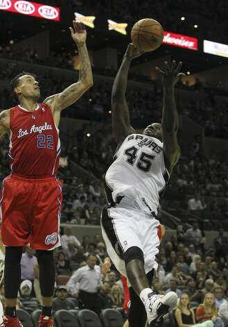 Spurs' DeJuan Blair (45) battles for a rebound against Los Angeles Clippers' Matt Barnes (22) in the second half of their game at the AT&T Center on Monday, Nov. 19, 2012. Clippers defeated the Spurs, 92-87. (Kin Man Hui / San Antonio Express-News)