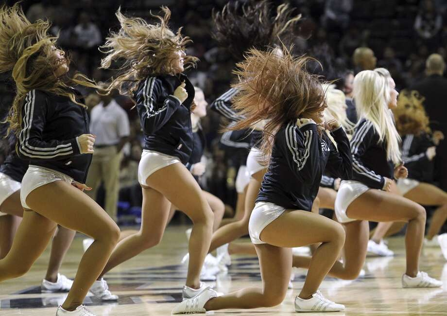 The Silverdancers perform during a timeout in the game against in the Los Angeles Clippers in the first half at the AT&T Center on Monday, Nov. 19, 2012. (Kin Man Hui / San Antonio Express-News)