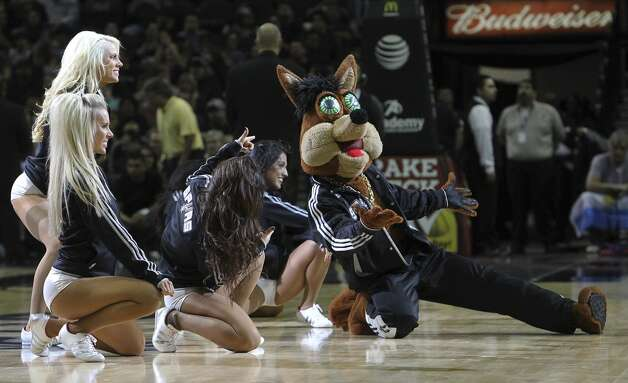 The Spurs Coyote and the Silverdancers perform during a timeout in a game against the Los Angeles Clippers in the first half at the AT&T Center on Monday, Nov. 19, 2012. (Kin Man Hui / San Antonio Express-News)