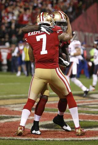 Quarterback Colin Kaepernick (7) celebrates with tight end Vernon Davis (85) after a touchdown in the first quarter of the San Francisco 49ers game against the Chicago Bears at Candlestick Park in San Francisco, Calif., on Sunday November 19, 2012. Photo: Carlos Avila Gonzalez, The Chronicle