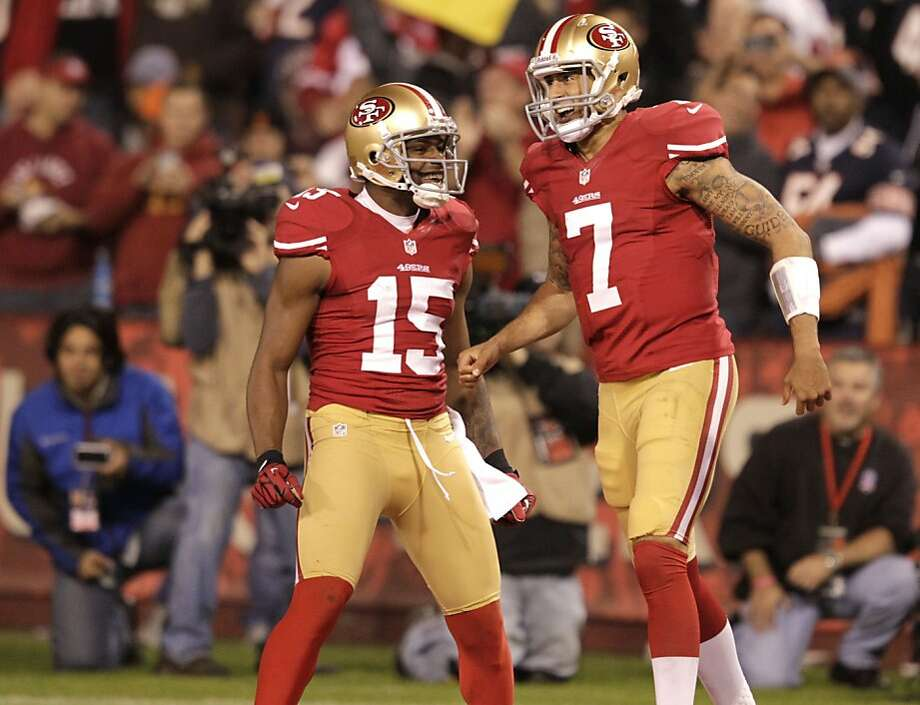 Quarterback Colin Kaepernick (7) celebrates with teammate wide receiver Michael Crabtree (15)  after a touchdown in the second half of the San Francisco 49ers game against the Chicago Bears at Candlestick Park in San Francisco, Calif., on Sunday November 19, 2012. Photo: Brant Ward, The Chronicle