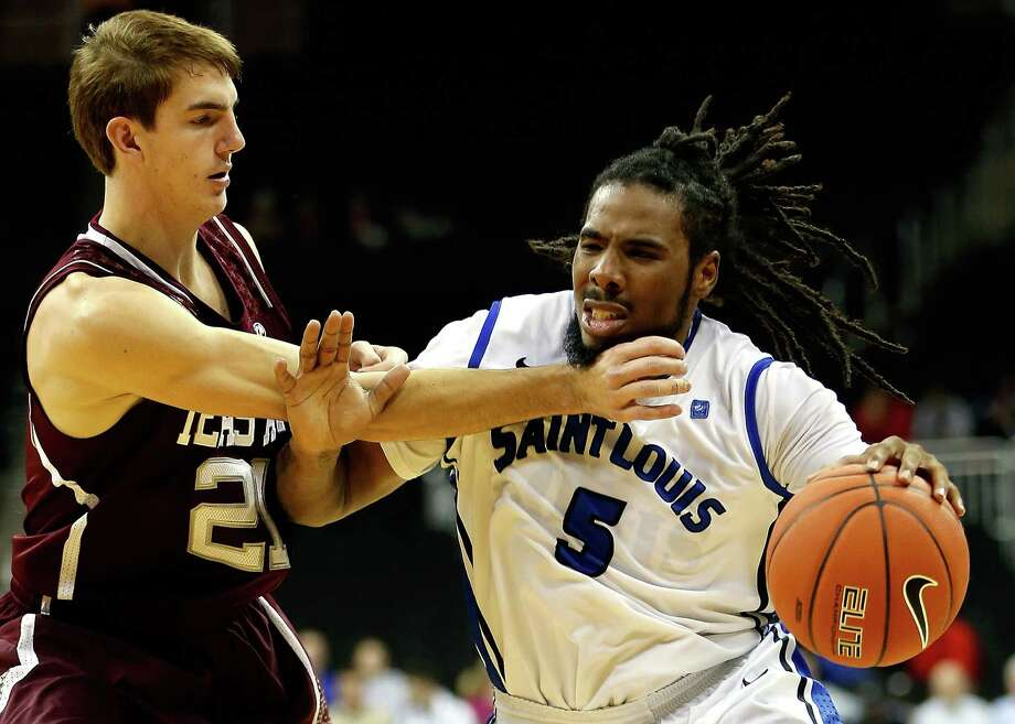 KANSAS CITY, MO - NOVEMBER 19:  Jordair Jett #5 of the Saint Louis Billikens drives as Alex Caruso #21 of the Texas A&M Aggies defends during the CBE Hall of Fame Classic at Sprint Center on November 19, 2012 in Kansas City, Missouri.  (Photo by Jamie Squire/Getty Images) Photo: Jamie Squire, Staff / 2012 Getty Images