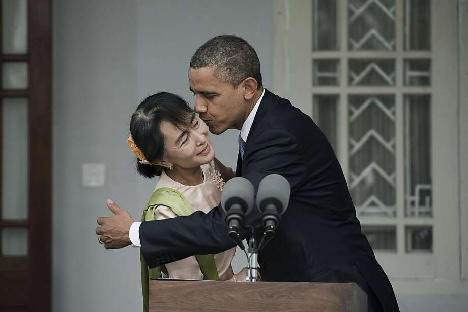 US President Barack Obama (R) and Myanmar pro-democracy leader Aung San Suu Kyi (L) kiss after speaking to the media during a brief joint presser at her residence in Yangon, on November 19, 2012. Obama arrived in Myanmar for a historic visit aimed at encouraging a string of dramatic political reforms in the former pariah state. Photo: Nicolas Asfouri, AFP/Getty Images